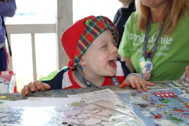 A child experiences the joy of summer camp during an on-therapy session of Smile-A-Mile. (contributed)