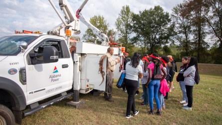 Students learn from an Alabama Power lineman. (Dennis Washington / Alabama NewsCenter)