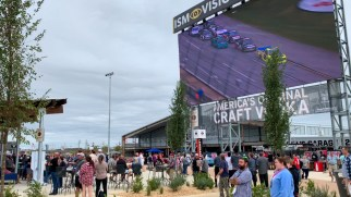 Fans enjoy the race from the courtyard of the new Talladega Garage Experience. (Dennis Washington / Alabama NewsCenter)