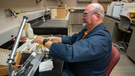 Alabama Power's Ron Hodge works in the laboratory analyzing oil from the company's transformers. Usually it's fine, but when it's not Hodge finds clues to potential problems before they become serious enough to cause power outages. (Dennis Washington/Alabama NewsCenter)