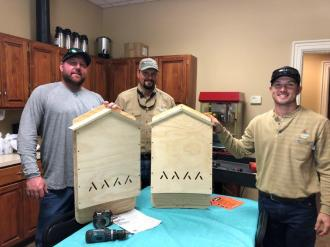 Alabama Power volunteers, from left, Keith Huckaby, Chris Denny and Andrew Terry in Valley built, painted and installed bat houses to help struggling bat populations in the state. (contributed)