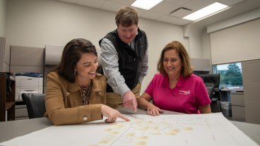 Donna O'Connor, right, on the job for Alabama Power with Berkley Horton, left, and Joe Norwood. (Dennis Washington/Alabama NewsCenter)