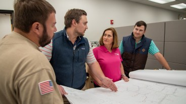 O'Connor works with engineers at Alabama Power. (Dennis Washington/Alabama NewsCenter)