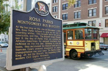 A trolley passes the site where civil rights icon Rosa Parks was arrested December 1, 1955, for not giving up her bus seat to a white man October 28, 2005 in Montgomery, Alabama. Rosa Parks changed history on December 1, 1955 when she refused to give up her seat on a city bus to a white passenger. Her arrest for this triggered a 381-day boycott of the Montgomery bus system. (Photo by Justin Sullivan/Getty Images)