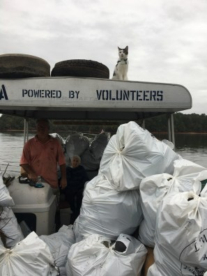 Ken and Tonya Holland and their supervisor with a load of trash removed from Lake Martin. (contributed)