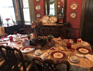 The dining table is set beautifully with antique dishes. (Donna Cope/Alabama NewsCenter)