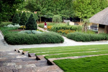 A visitor walks through the gardens at the Alabama Shakespeare Festival. Each plant in the garden is mentioned in one of Shakespeare's plays and is marked with the play and scene in which it appears. (From Encyclopedia of Alabama, courtesy of the Alabama Tourism Department)