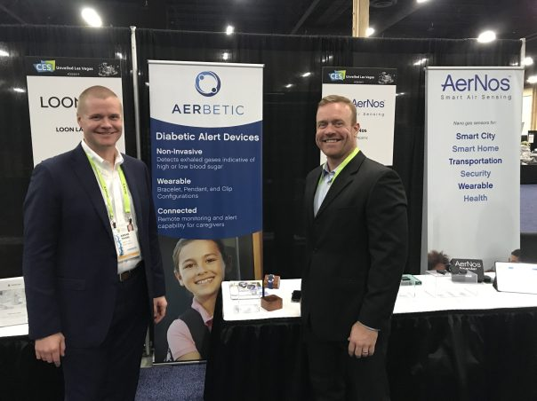AerBetic co-founders Arnar Thors, left, and Eric Housh stand at the AerBetic booth at CES 2019, where the diabetic alert device created a stir. The AerBetic team is back at the top consumer tech show in Las Vegas this year. (AerBetic)
