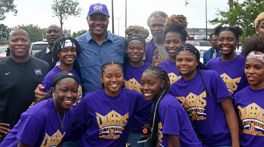 Charles Barkley poses with members of the Miles College women's basketball team during a September visit to the campus. (Solomon Crenshaw Jr./Alabama NewsCenter)