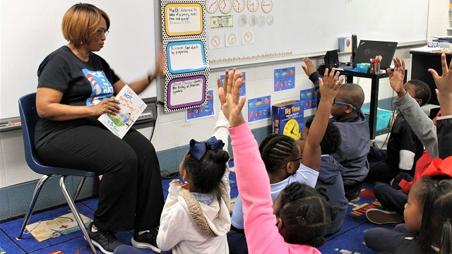 APSO volunteers help Alabama students discover the magic of reading