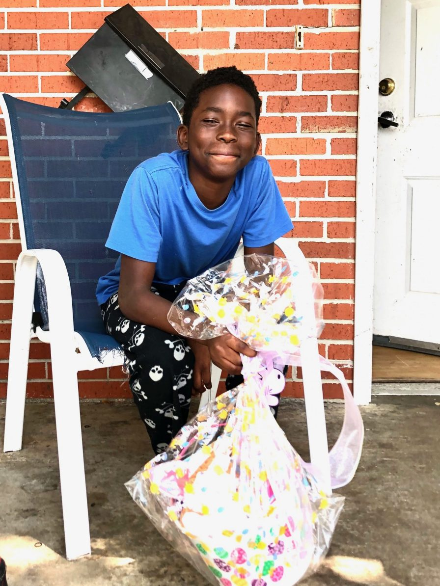This youngster was happy to receive an Easter basket from Light of the Village. (John Eads/Light of the Village)