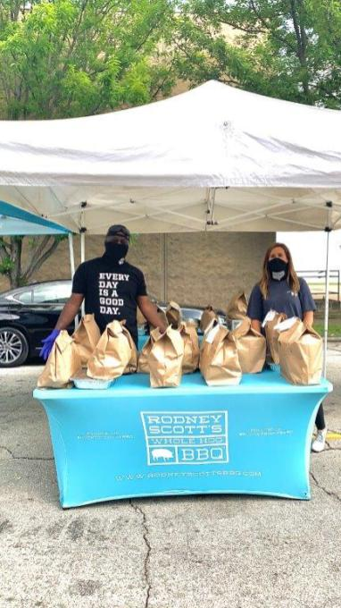 Rodney Scott was the man behind the mask at the Rodney Scott BBQ tent at the Market at Pepper Place Memorial Day weekend. (Angie Mosier)