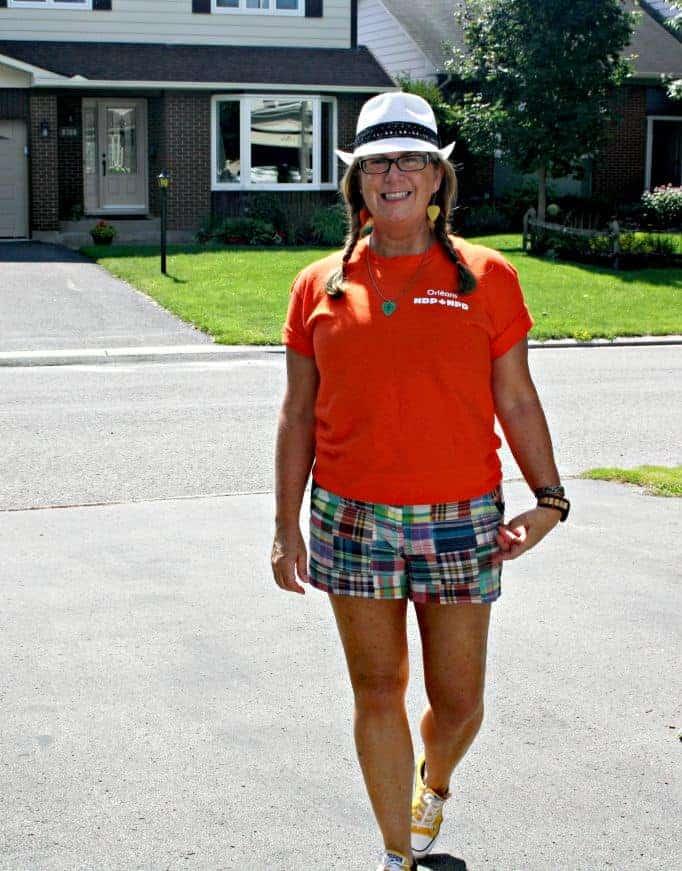 Orange shirt for NDP and J Crew plaid shorts with fedora