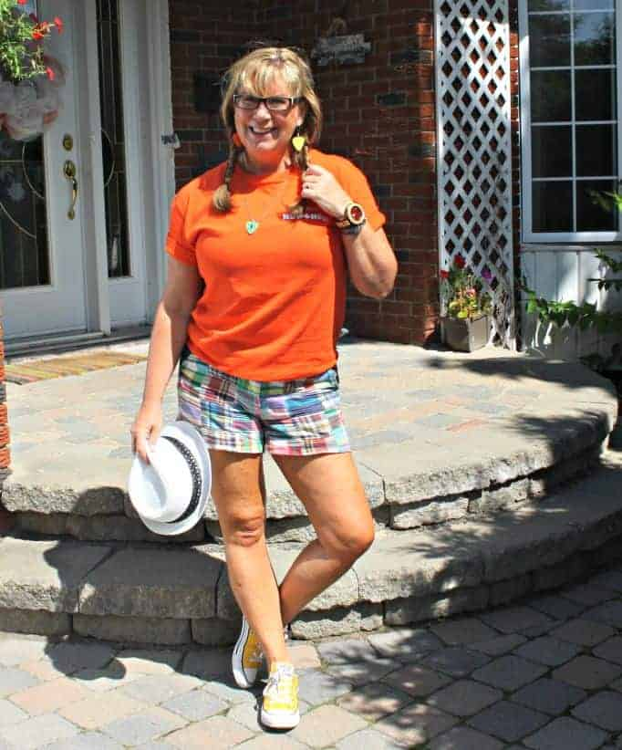 Orange shirt for NDP and J Crew shorts with fedora