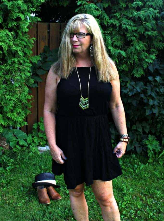 black dress, with fedora and booties and a jord watch