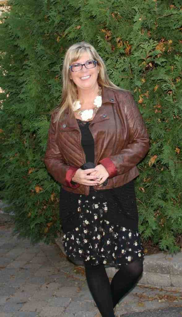 moto jacket and floral chiffon skirt, with konifer glasses and a happiness boutique necklace