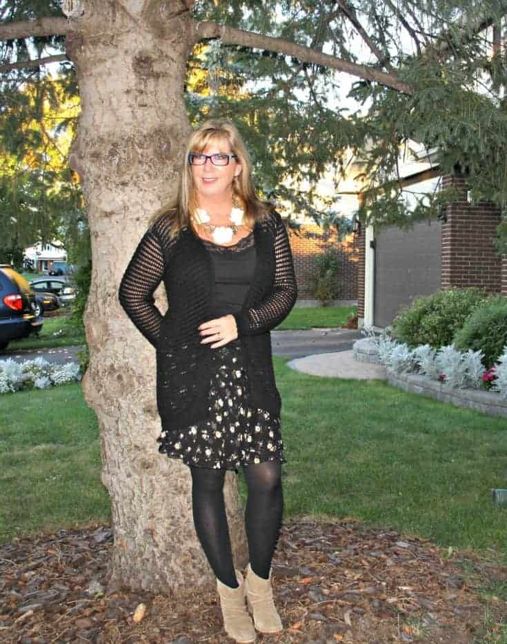 open weave sweater and floral chiffon skirt, with konifer glasses and rodeo boots