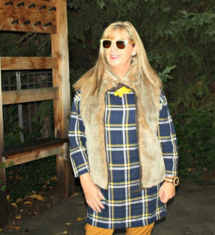 Old navy plaid tunic and pixie pants with a fur vest with jord watch