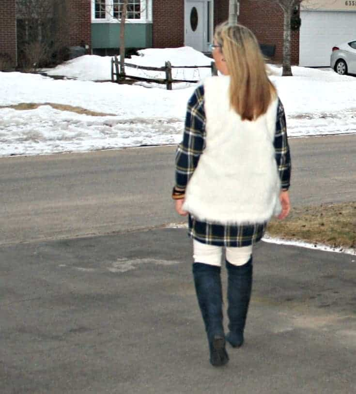 old navy blue plaid dress and white fur vest and suede boots with white denim in winter