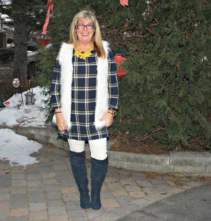old navy blue plaid dress and white fur vest and blue suede boots and floral necklace
