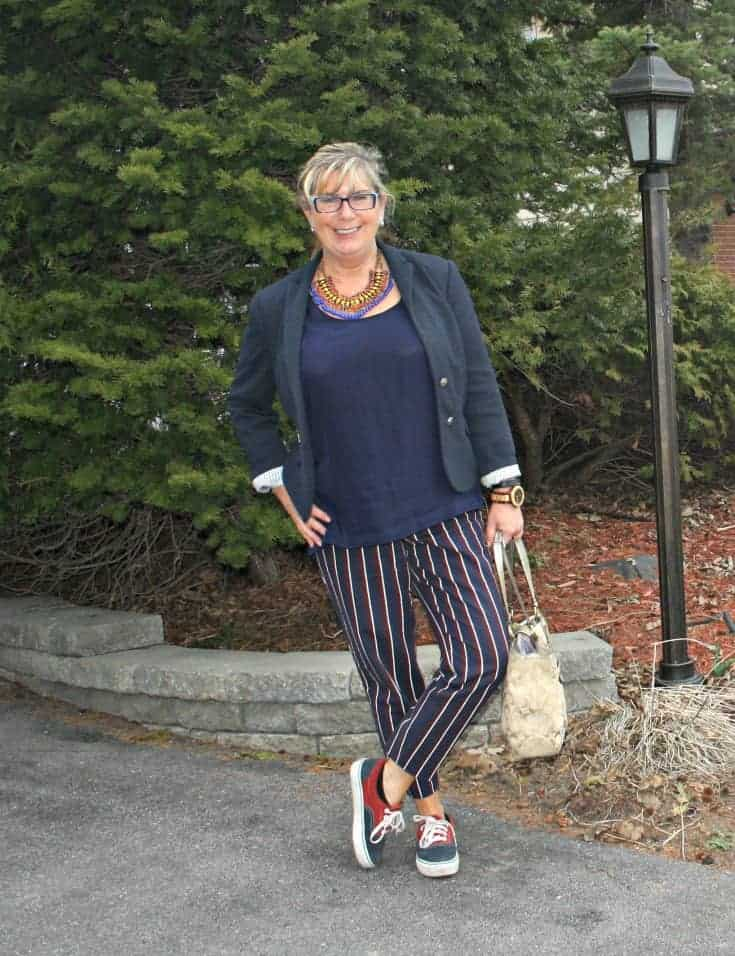 Harper striped pants, navy blazer and vans with a coach bag and a Jord watch