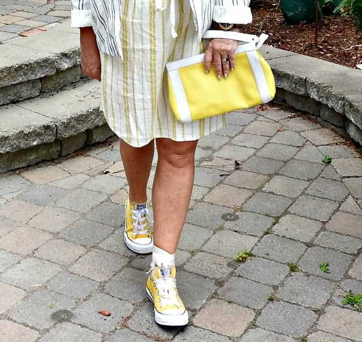 yellow converse and a kate spade clutch