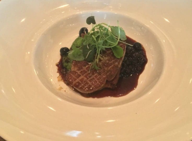 Pan Seared Quebec Fois Gras, with Toasted Banana Bread.  Topped with a fresh Blueberry Ginger Compote and Walnut Arugula Pesto at St Germain's