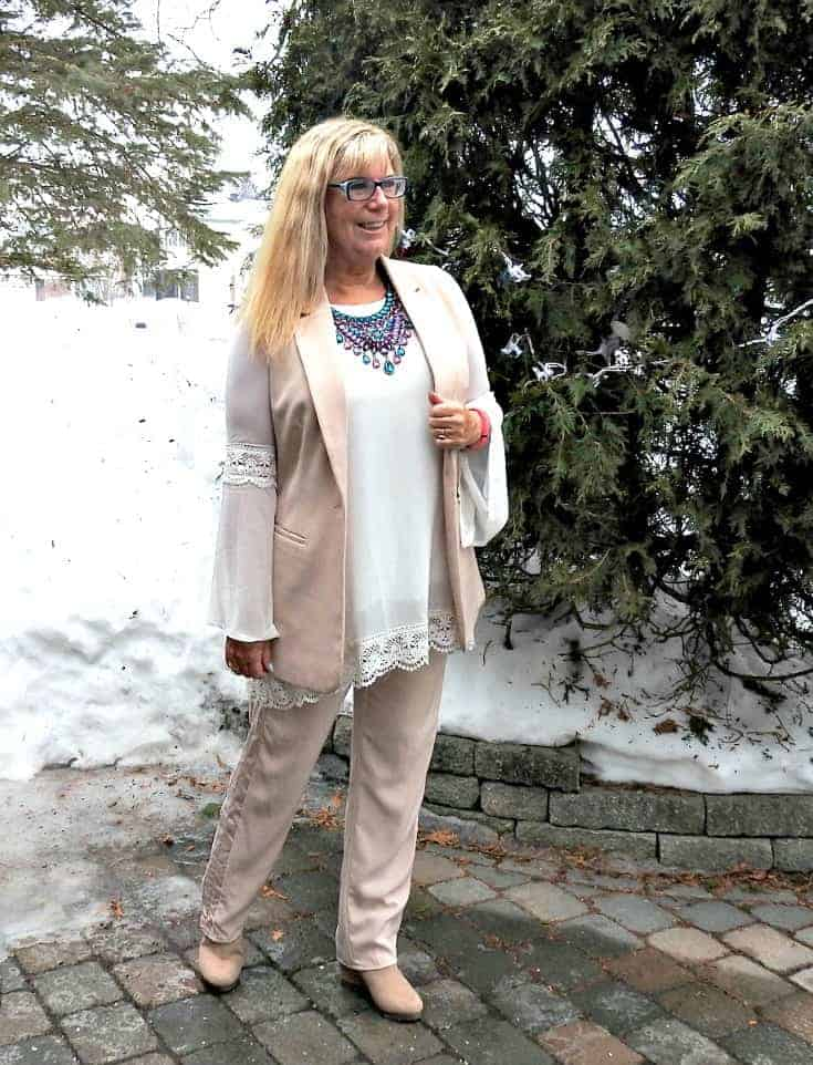 Blush Pant Suit with a 7 Charming Sisters Necklace and a cream lace tunic