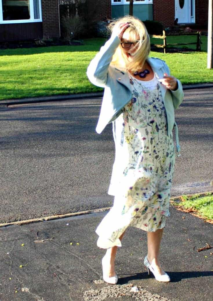 wind blown in h&M floral dress with striped shoe dazzle pumps and a moto jacket