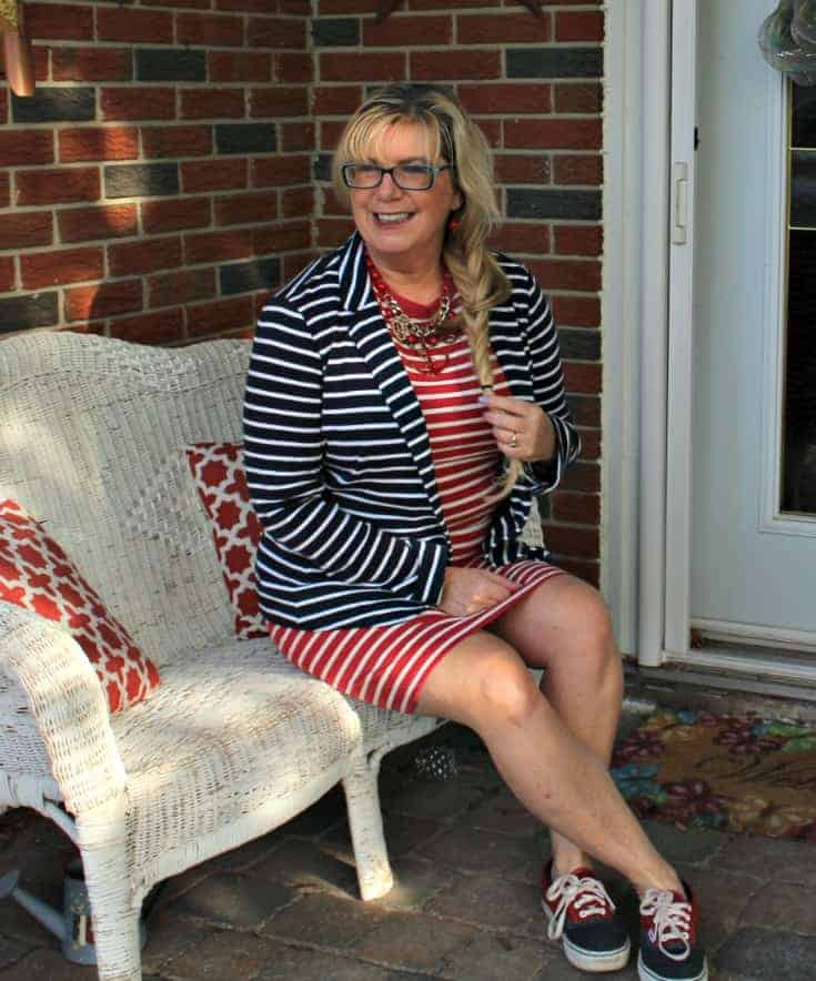 sitting in an Old Navy Stripe dress with a contrasting blazer and two tone vans