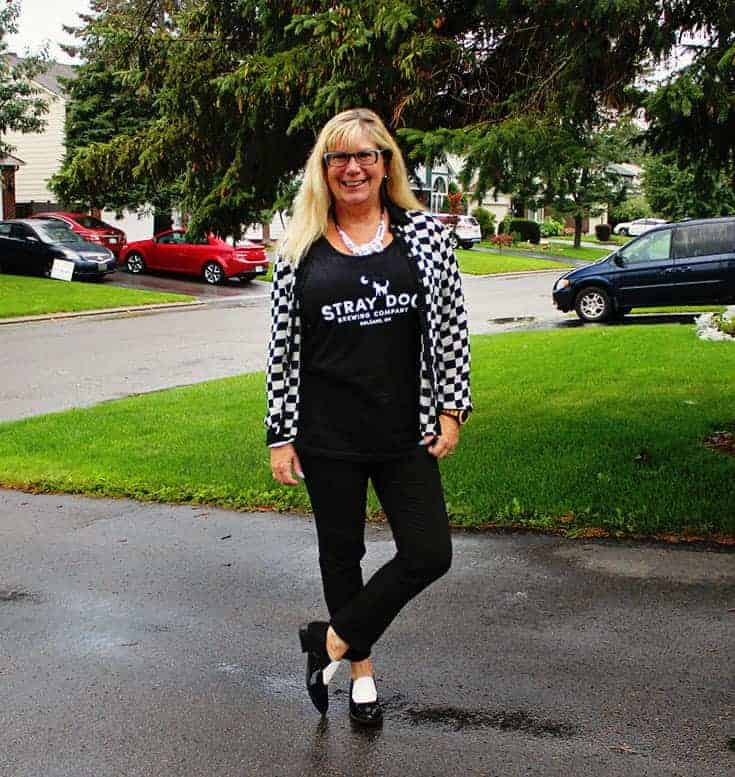 slim pants from Vanheusen with a houndstooth top and a Beer tank with circus by Sam edelman loafers