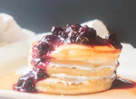 dinner feature pancake stack with bourbon blueberry compote