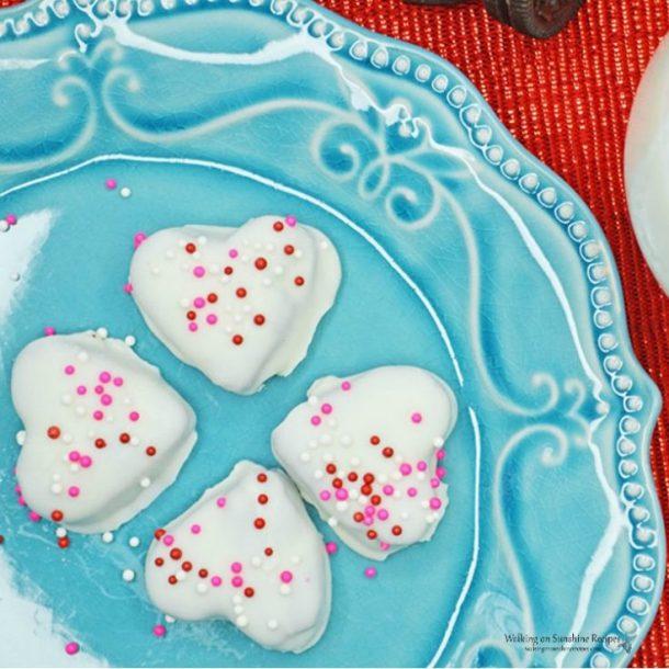 oreo heart shaped truffles on a blue plate