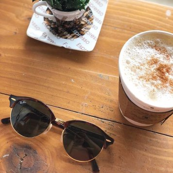 Ray Ban sunglasses and a cup of coffee