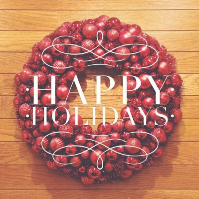 "Photo of a Christmas wreath with the words ""Happy Holidays"" overlayed"