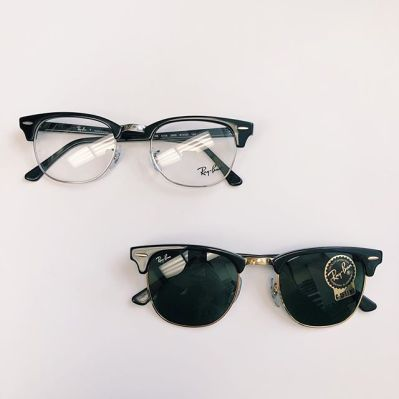 Photograph of 2 pairs of Ray Ban eyeglasses and sunglasses.