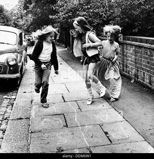 Children playing hopscotch on a London street, c1970. Artist: Henry Grant Stock Photo