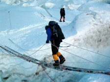 Alan crossing a crevasse in the Khumbu Icefall