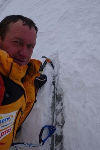 Denis Urubko chopping out old rope on K2 courtesy of russianClimb.com