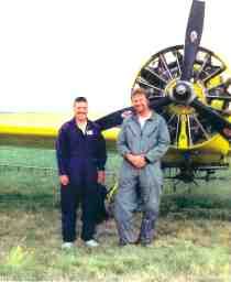 Rebecca's son John (on right) and a mate in front of their aero ag plane.