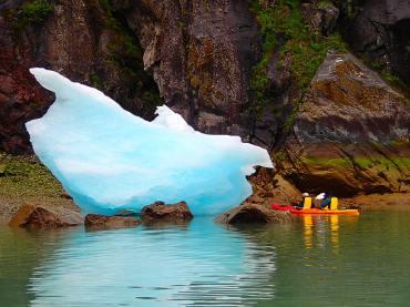 Kayakers Near Shore with Iceberg