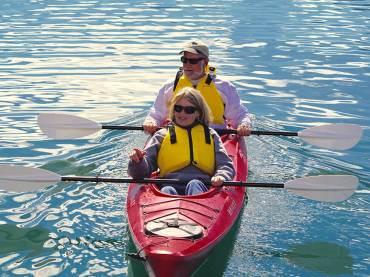 Couple Prepares to go Sea Kayaking