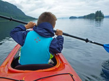 Boy in the Front of a Sea Kayak