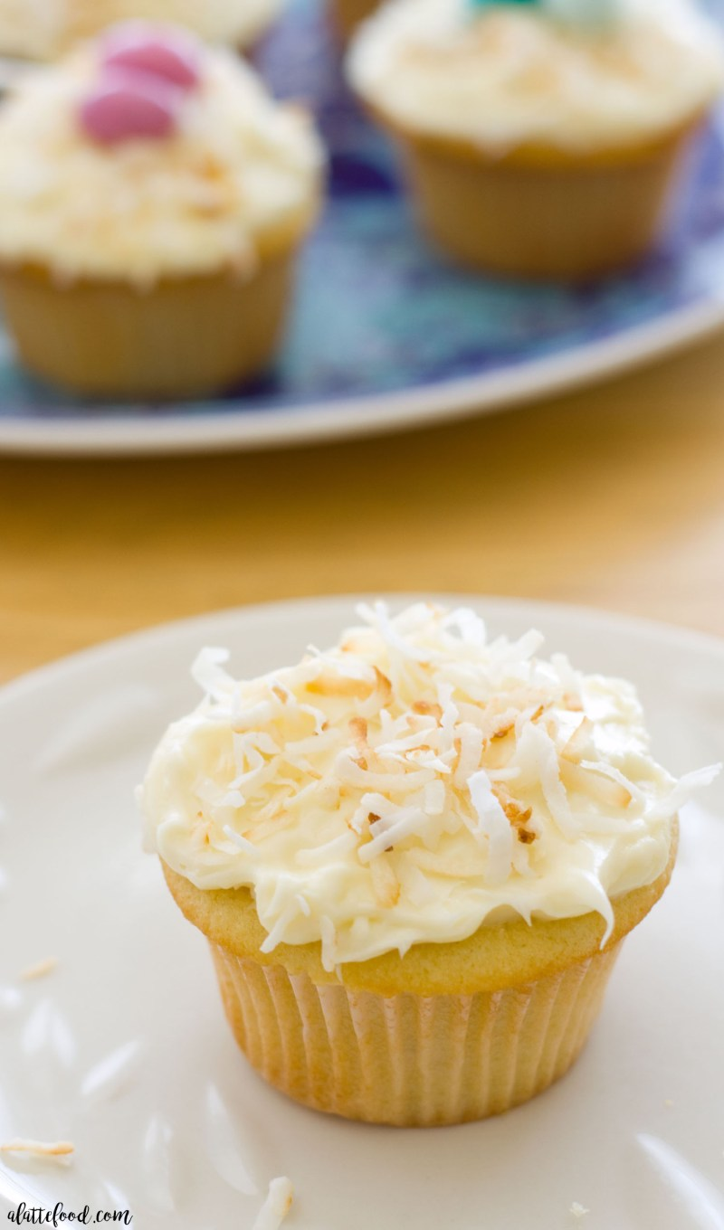 These easy coconut cupcakes are rich, sweet, and full of coconut flavor! They're topped with chocolate eggs, making them a perfect Easter dessert or spring dessert! Homemade coconut cupcakes are fun, easy, incredibly simple to make!