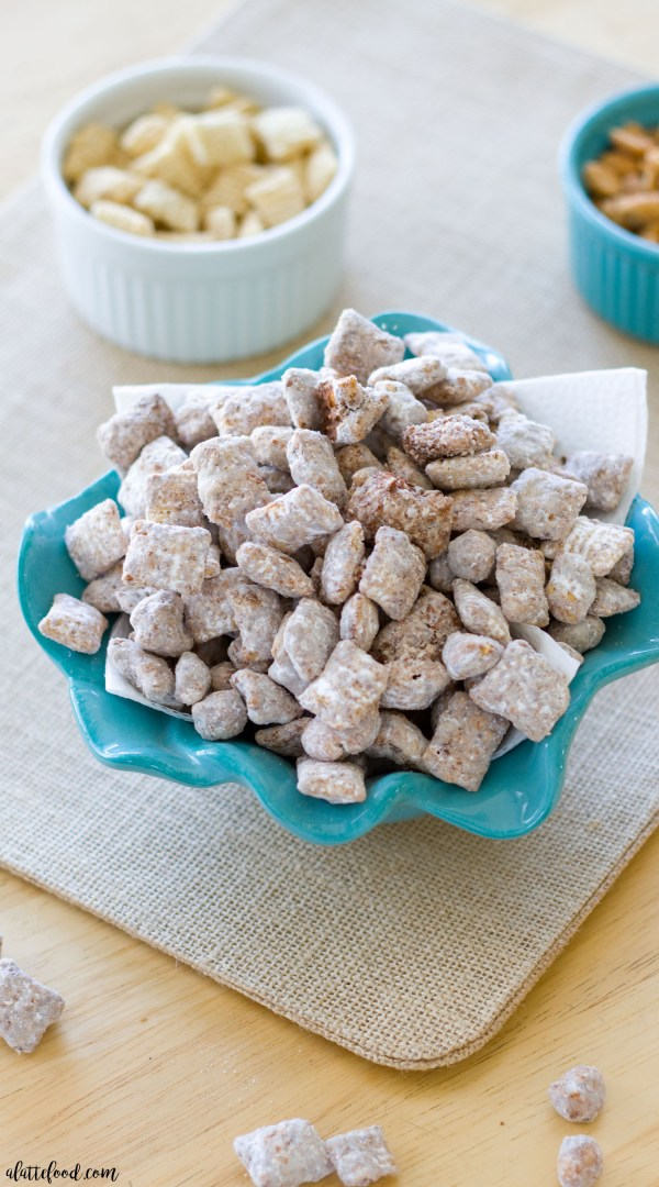 This easy puppy chow recipe (aka muddy buddies recipe) is full of Nutella, peanuts, and sea salt! This Sea Salted Nutella Peanut Puppy Chow is one easy snack you'll want to eat over and over again!