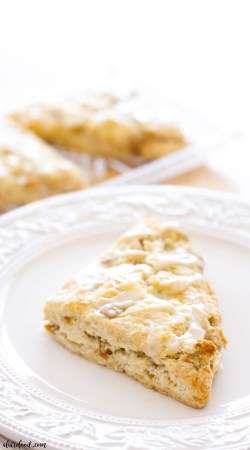 These easy homemade apple pie scones are light, flaky, and incredibly sweet. Homemade scones are so simple to make at home, and these apple scones are sure to be a family favorite! They are full of sweet apple flavor and topped with a subtle maple glaze. These apple scones taste just like apple pie, and great for breakfast, brunch, or an afternoon snack!
