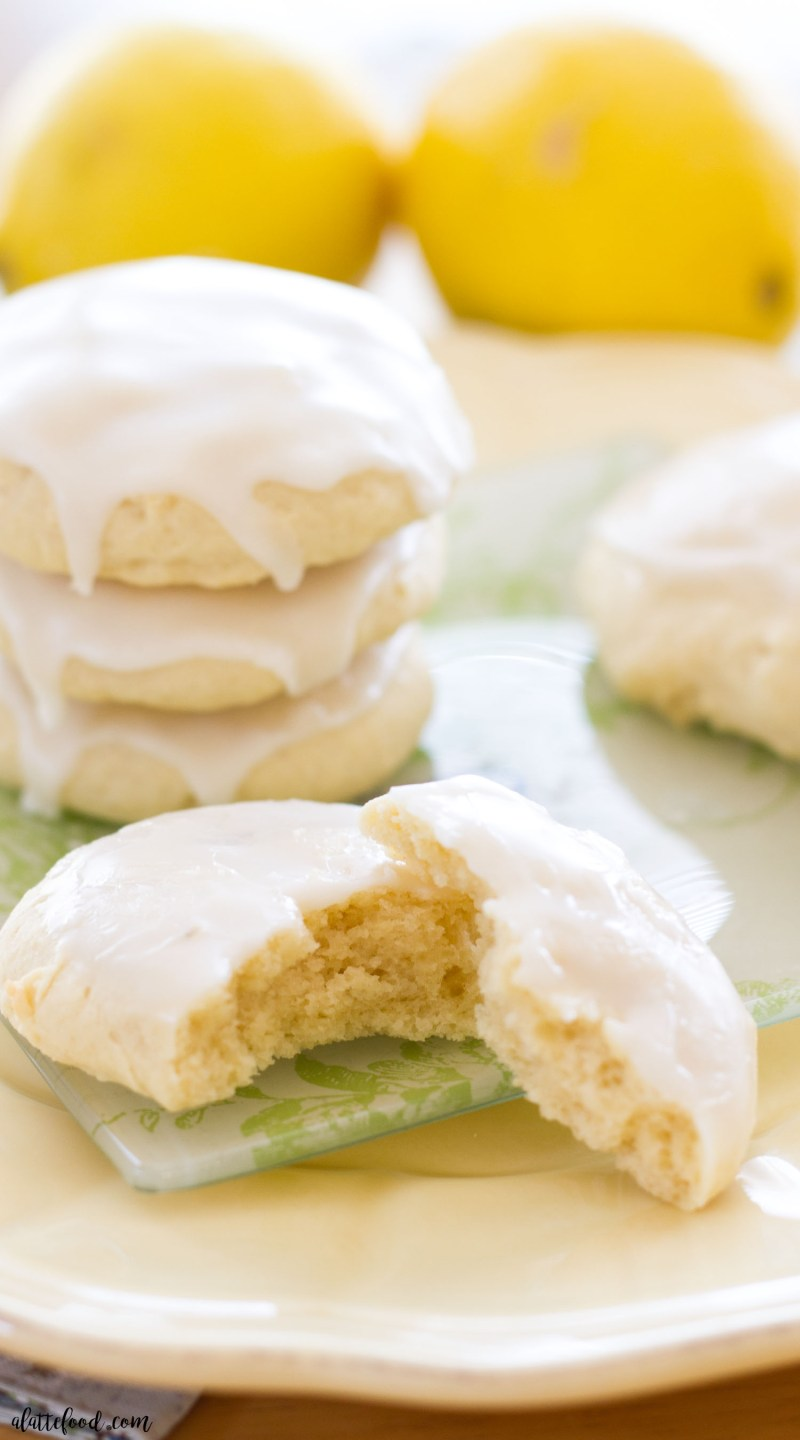 These soft-baked lemon sugar cookies are super soft and tender, and topped with a sweet homemade lemon glaze! If you love lemon recipes as much as I do, this lemon sugar cookie recipe is just for you! lemon/cookies/lemon cookies