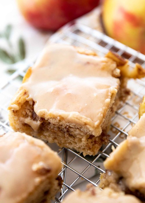maple apple coffee cake slice on silver rack