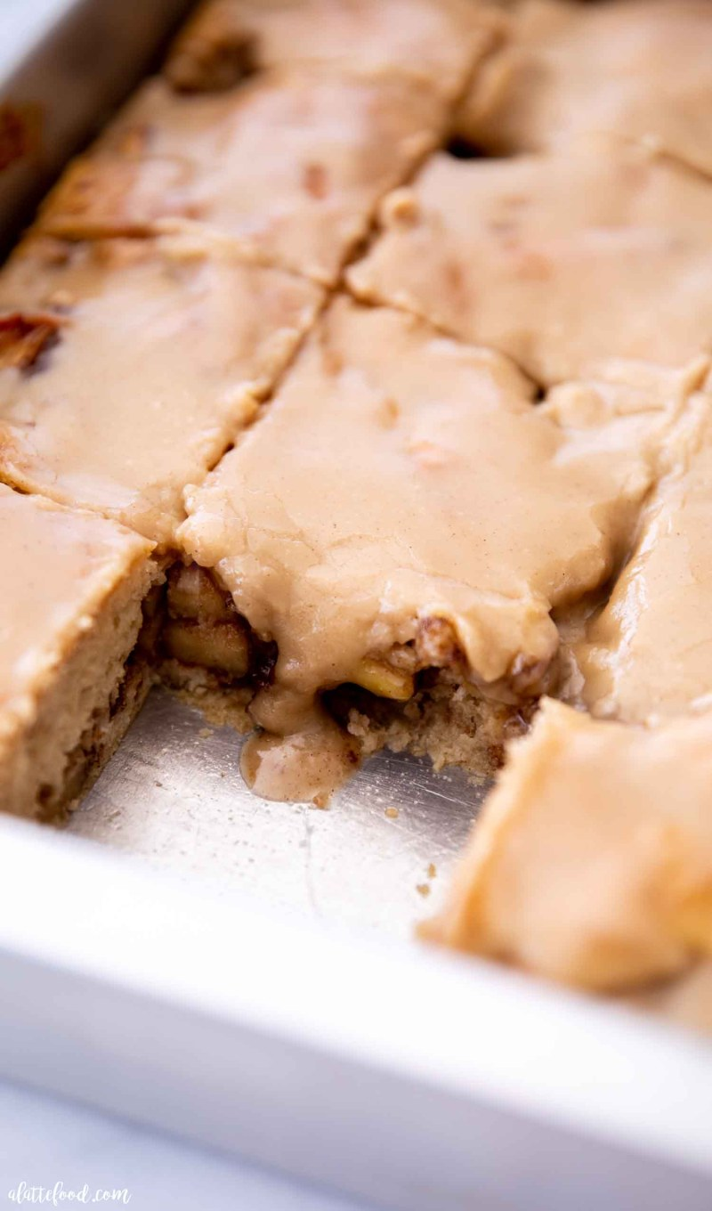glazed maple apple coffee cake slices in baking dish