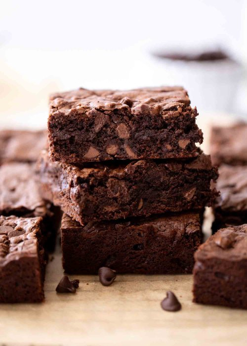best fudge brownies made with melted chocolate and chocolate chips stacked on top of each other